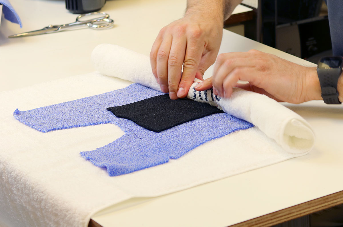 Using a towel to roll excess water out of Muenster orthosis pattern.