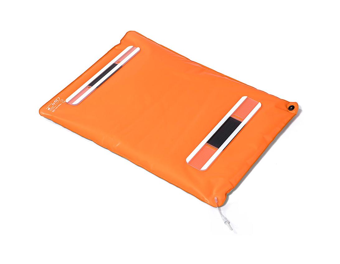 Underside of an orange Orfit Vacuum Bag with indexing laths.